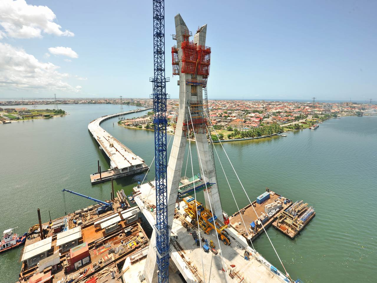 Aerial view of pylon & main bridge under construction with cables in place (julius-berger-int.com)