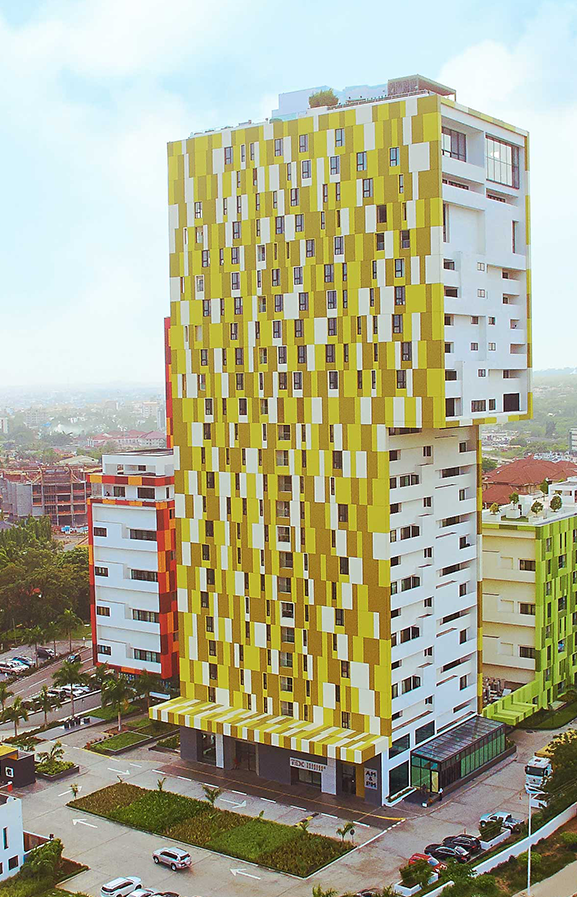 Side view of completed 30 storey Alto Tower with Yellow Kente-patterned facade (trasaccogroup.com)