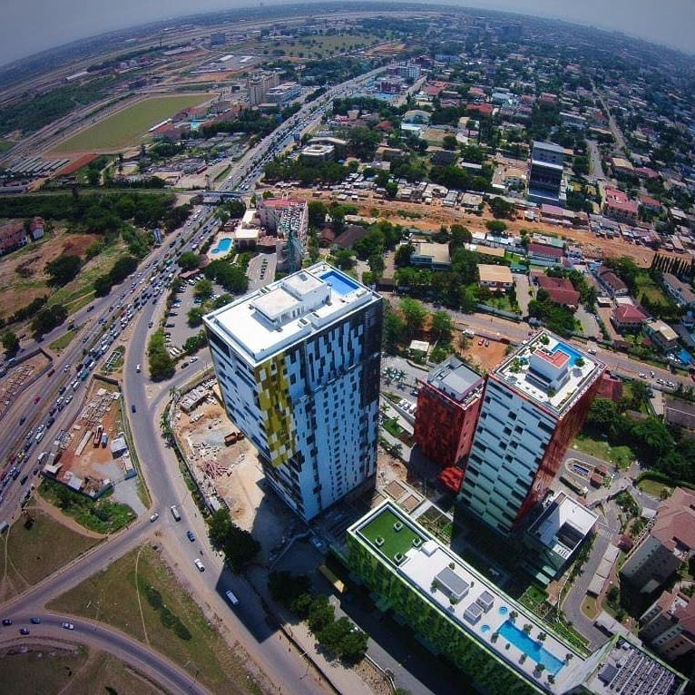 Aerial view of completed Villagio Vistas against background of Accra city (@worldsfinestdestinations_ on instagram)